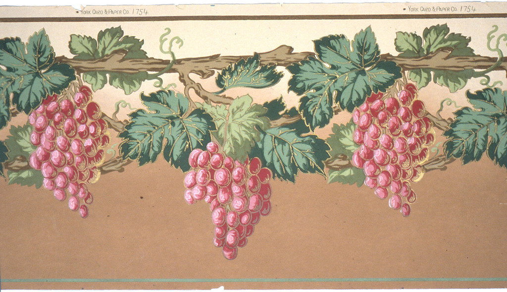 Large clusters of grapes and leaves hang from grape vine. Printed in red, green and brown, on background that shades from tan at top to brown at bottom