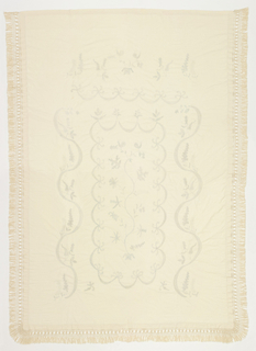 """Candlewick"" bedcover of cotton muslin embroidered in knotted stitches in cotton. Bordered on three sides with off-white cotton fringe."
