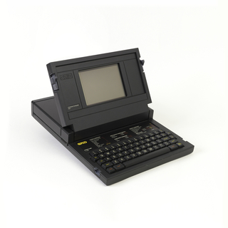Black rectangular housing, hinged at top center to open, clamshell-style, revealing a screen and keyboard.