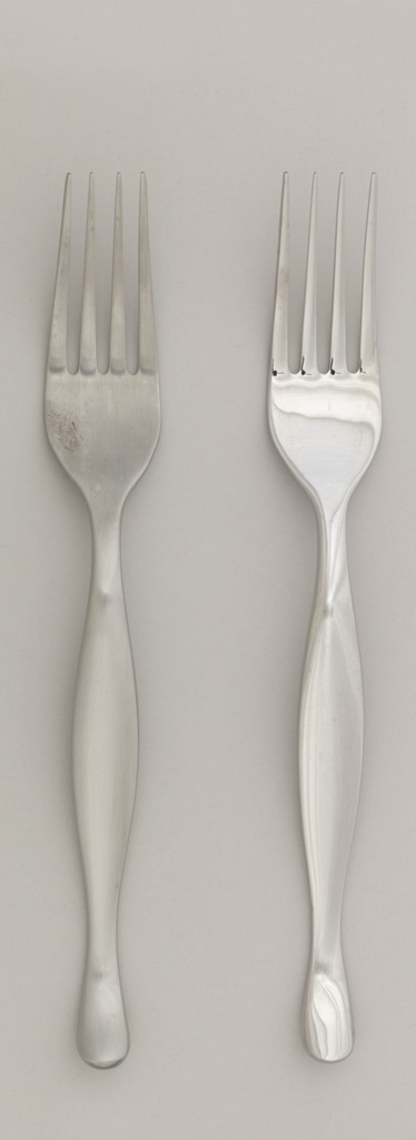 Manufacturer's prototype: four-tined fork with curved contoured handle; matt surface.