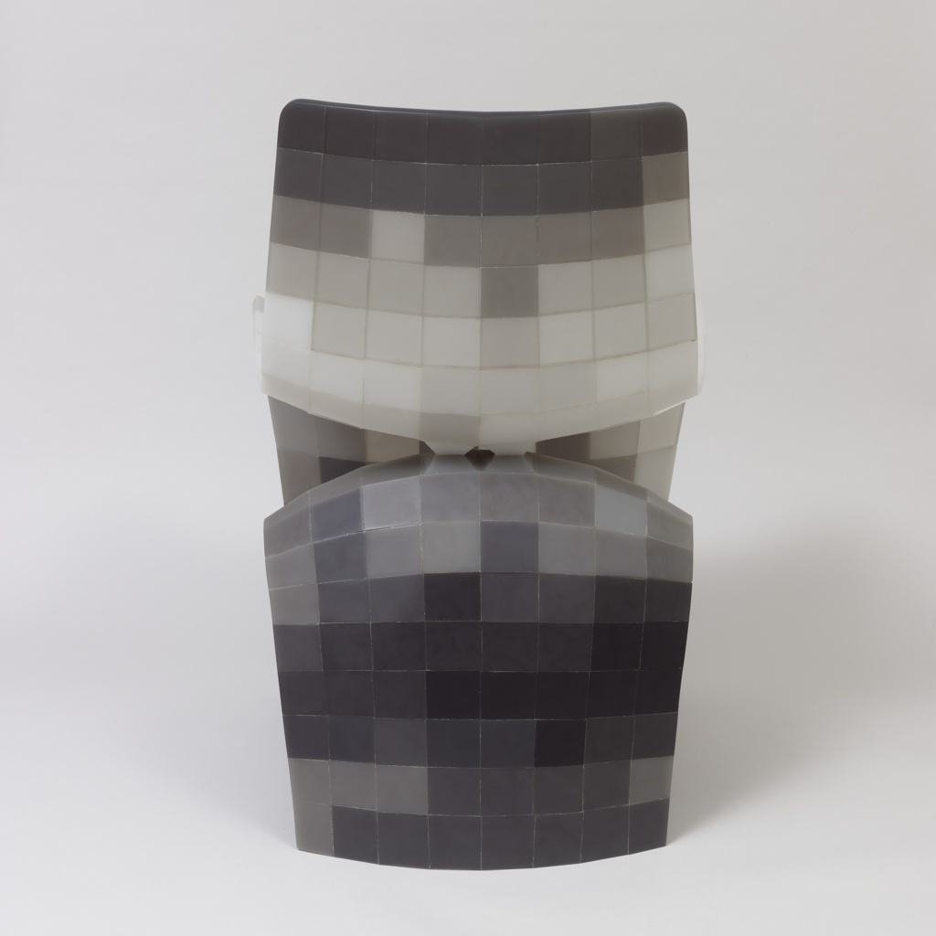 Undulating, contoured ribbon-like chair composed of 294 resin pieces in shades of white, gray and black, each shaped to fit into its precise location within the form.