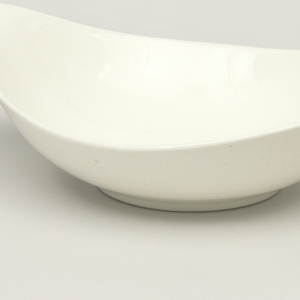 Teardrop dish with everted handle.