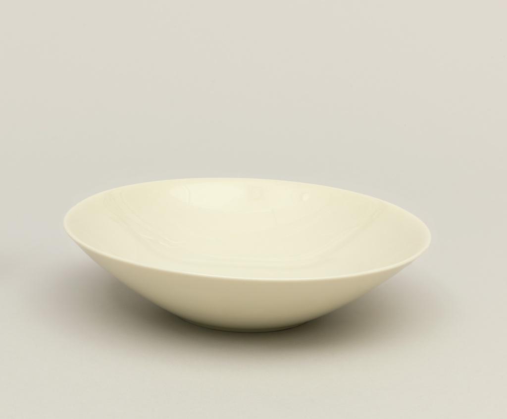 White porcelain bowl with round angular rim.