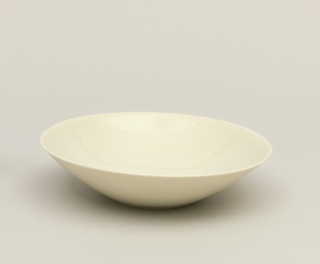 White porcelain bowl with round angular rim.