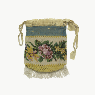 Knitted bag with colored glass beads in design of a band of flowers on a white ground, with a band of blue above and yellow below. Silk ribbon at top for closing; bead fringe at bottom; kid lining.