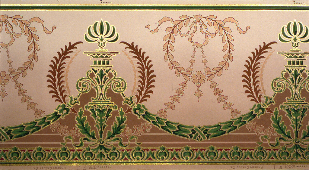 Torch-like motif supported by foliate sprigs tied together with ribbon. Motif is enclosed within a wreath, and connected by foliate swags. Background pattern of wreath with bow knot, connected by swags. Band of stylized egg and dart motif across bottom.  Flitter frieze with elements outlined in gold mica flakes. Printed in green.