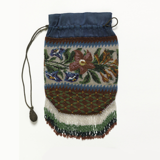 Knitted bag with colored beads in design of floral band above leaf pattern arranged  in lozenge design; bead fringe. With blue satin at top with metal cord and balls.