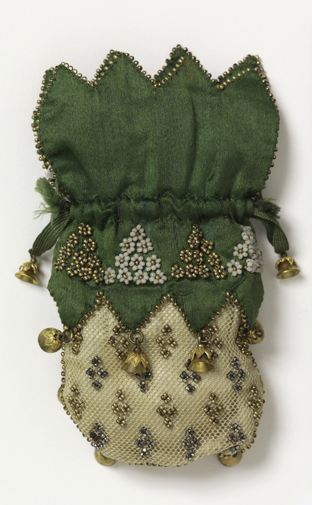 White crocheted net miser's purse with cut steel and gold colored beads; top of soft green satin with scalloped edge, ornamented with triangular groups of gold and white beads. Edged with gold beads and tipped with gold bells, which hang down over net section. With a gold bell at each end of the drawstring.