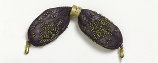 Crocheted purple silk ornamented with gold beads in diamond pattern.  Two small gold rings control side opening; small gold drops at either end.