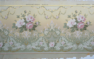 Flitter frieze with rose bouquets outlined in gold mica flakes. Foliate swags hang above, with scrolls and lace-effects below. Printed in red, white and green on background that shades from tan at top to green at bottom.