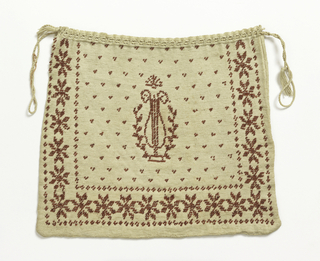 Rectangular bag of white knitted cotton with drawstring top. Design in red beads of a lyre in a dotted field, surrounded on three sides by a border of stylized rosettes.