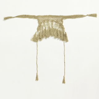 Head covering or cap with two long tassels and cords to tie.