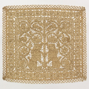 Needle lace rectangle with a central panel containing two confronted full-face lions facing a central vine-like tree. The scrolls of the tree enclose birds, leaves and two rabbits. Continuous outer border of an open twist framing small rosettes.