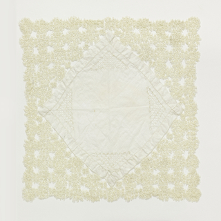 A square fabric made larger by triangles of tatting added to each side.