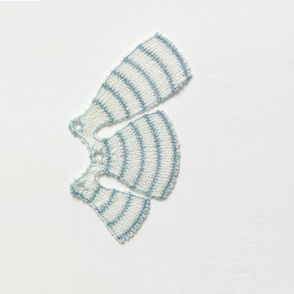Bioimplantable device for reconstructive shoulder surgery with three tabs of different lengths projecting out in a semicircular form, machine embroidered in white and blue polyester with the base cloth dissolved for a lace-like effect.