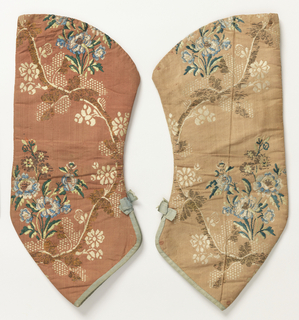 Pair of sleeves which would have been tied onto an 18th century dress. Left sleeve badly faded. Coral-colored ground with a curving vine with blue and white flowers. Finished at bottom with blue binding and small bow.