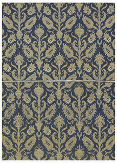 Symmetrical floral sprays in half-drop alignment in blue, white and tan.