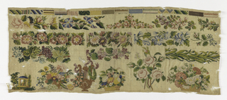 Sixteen rectangles of pattern at the top. Field filled with bands of floral pattern, floral motifs at bottom.