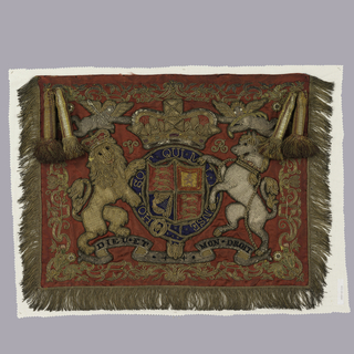 Trumpeter's banner in red damask, embroidered in gold and silver metallic yarns with a England's crest flanked by the lion and unicorn, with gold metallic fringe and large tassels.