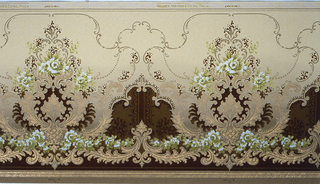 Large foliate medallion with floral bouquet. Printed in shades of tan, brown and green on background that shades from tan at top to brown at bottom. Small floral swag and scrolls along bottom edge.