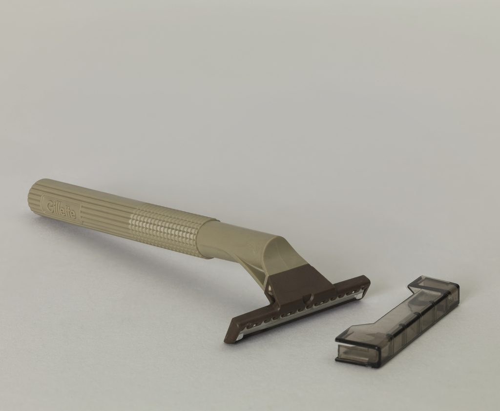 Taupe body, brown razor shield, with horizontal grooves in handle.