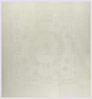 Tablecloth with a central design of a classical vase with figures surrounded by a wreath and medallions with figures.