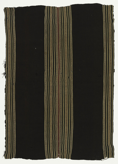 Two panels stitched together; both have a dark brown ground with vertical stripes of maroon, white, blue and white; and red, yellow and white. Geometric patterning in the colored stripes. Selvages turned back and hemmed.
