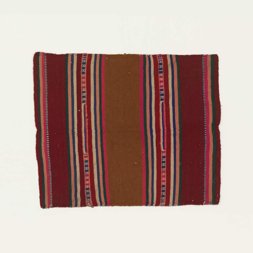 Sample woven by Elena Izcue as a reproduction of early Peruvian weaving. Polychrome stripes with red predominating.