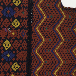 Huipil made of three lengths stitched together. Dark blue cotton cloth with double warps and double wefts covered in long red floats. Design of triangles and diamonds in blue, green, and yellow forming bands.