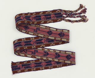 Double-faced belt with continuous stylized design of birds and rosettes widely spaced on band. Blue-green on dark red with opposite on the reverse. Red and white borders with purple edges. Long thick plaited fringe on one end.
