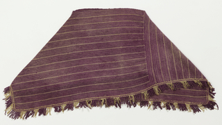 Poncho-type garment in white and purple stripes with fringe. Purple color comes from the Central American shellfish dye known as caracol.
