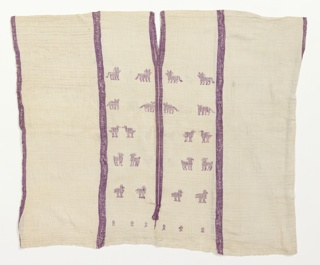 Huipil made from three lengths of fabric, and each length has four selvages. The selvages are stitched together to fashion the garment with small holes remaining for the arms. Purple warp stripes are present on the edges of all three lengths. The wider central panel is patterned on one side with small animals and birds in white and purple. Center panel also has two groups of supplementary warps that are set into the middle of the fabric. Neck slit was made during the weaving process. Both ends of the supplementary warps create fringe about 2.5 inches from the bottom edge of the garment. Neck opening reinforced by widely spaced button hole stitches. Purple dye known as caracol is made from snails (plicopurpura pansa) native to the Pacific coast of Mexico. Very rare.