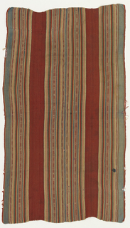 """Wool textile with vertical polychrome stripes dominated by red and blue-green. Several narrow stripes are patterned with small """"s"""" shapes."""