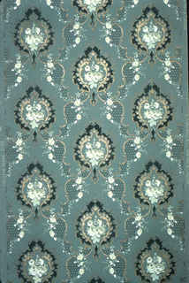 On dark turquoise ground, treillage composed of honeycombs bordered by gold scrolls and white flowers, with anthemion motifs of frames in gold C-curves, black frame surrounding cluster of white flowers.