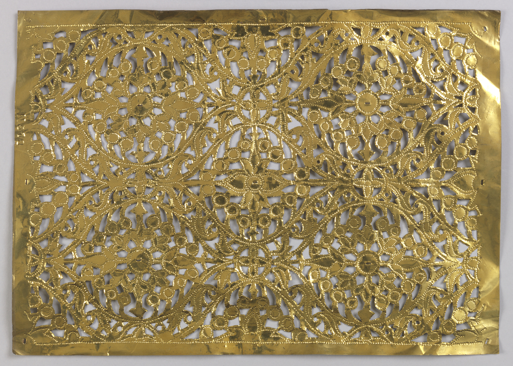 a large rectangular panel with ogival foliate curves centered by an arrangement of flower heads and beads, in three rows of altenating drop shapes