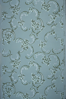 Non directional, foliate scrolls and floral motifs. Printed in green and white on blue-gray ground.