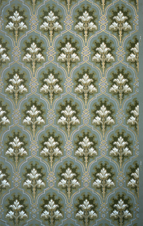 On blue ground, treillage of zigzags in white and gold containing floral fan-like bouquets printed in green, brown, gold, white, and gray.