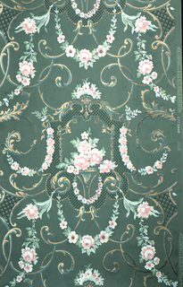 On green ground, treillage of floral rinceaux in white and pink, scrolls in green and gold; at center vase of bouquet of white and pink surrounded by black trellis, framed by gold beads.