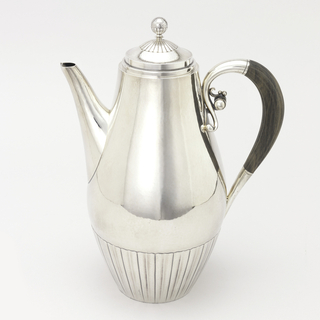 Pear-shaped coffee pot (-1a) with band of vertical reeding at bottom; silver and ebony loop handle with scrolling foliate terminals at top of loop; spout opposite. Circular, domed lid (-1b) with spherical knob at top.