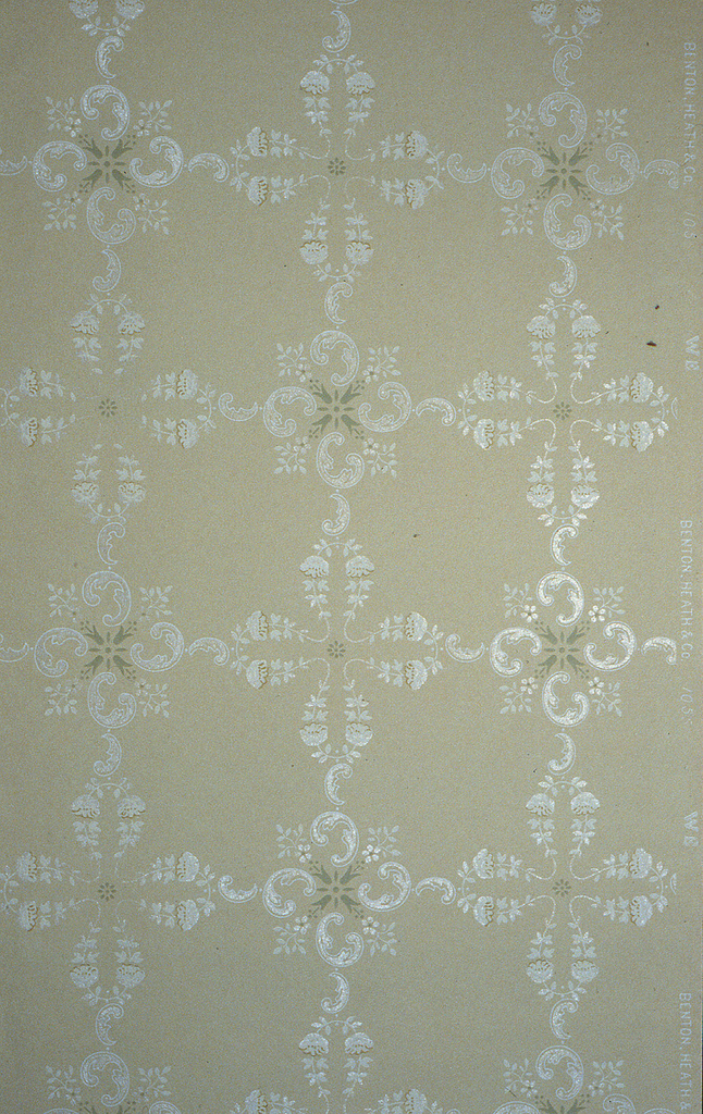 On gray ground, white cross motifs alternating; one with petals made of white floral rinceaux and the other composed of C-scrolls.