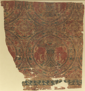 Fragment of woven silk with large tangent roundels. Each roundel contains a symmetrical design of a bearded man strangling a lion in each arm. A small animal is under each lion's feet and a pair of small birds appear between the strangler's feet. The roundel frame consists of confronted griffons with pearl guard bands. 
