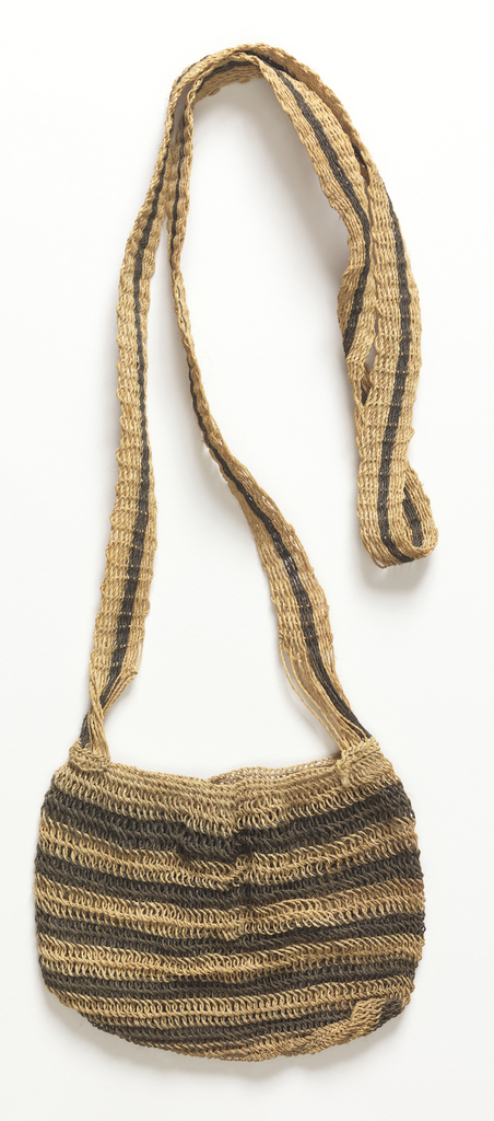 Small bag striped with narrow alternating bands of natural and black, with a long striped strap.