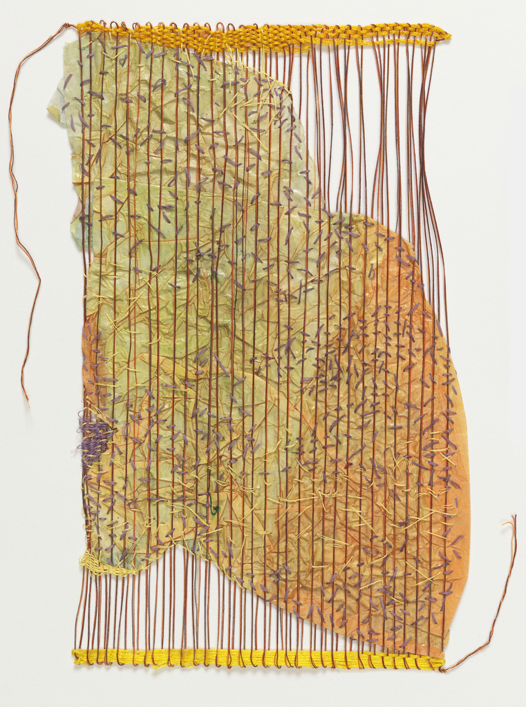 The tripled floating warps of brown, orange, and yellow are stiffened with bookbinder's paste. Sheets of dye transfer paper in orange and yellow-green are crushed and inserted between the warps, and stitched in place with small running stitches.