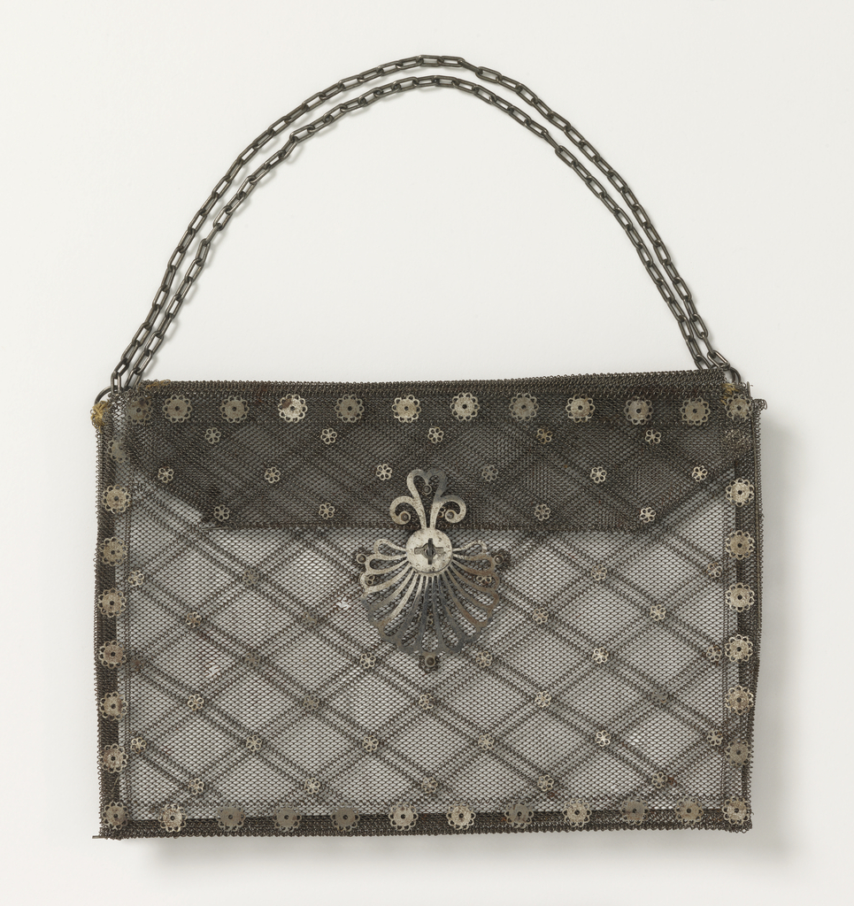 Purse is horizontal rectangle of interlinked wire ornamented with attached spangles. Handle is a chain of linked wire.