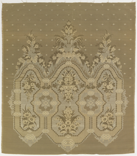 One repeat of a large symmetrical triple-crowned floral ornament against a grey-green ground with minute flowers. Ivory warp, beige weft.