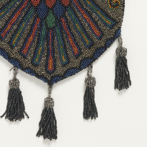 Oblong shape with tapered bottom. Embroidered with multicolored beads in a design of a winged scarab. Design is the same on front and back.