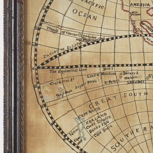 """Two hemispheres containing maps of the world with a medallion at top reading """"A new map of the world with the late discoveries in the southern seas worked by Eliza Thompson 1796.""""  At bottom is a compass.  Continents are outlined with chenille thread."""