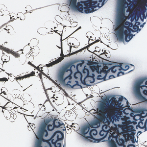 "Two Chinese characters spelling ""China"" and modelled in ceramic are placed in front of a background of white blossoms. Ceramic modelling fabricated by Sonny Kim."
