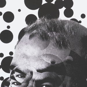 An asymmetric collage of Niklaus Troxler's portrait in front of a background of black blots in various sizes. Details of the exhibition are printed in diagonals at the lower left corner of the poster.