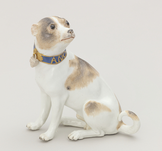 "Figure of a brown-spotted pug with cropped ears and a long tail.  Blue collar banded and inscribed in gold ""ANO 1741.""  Collar secured by padlock."